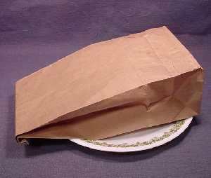 popping-popcorn-in-brown-paper-bag
